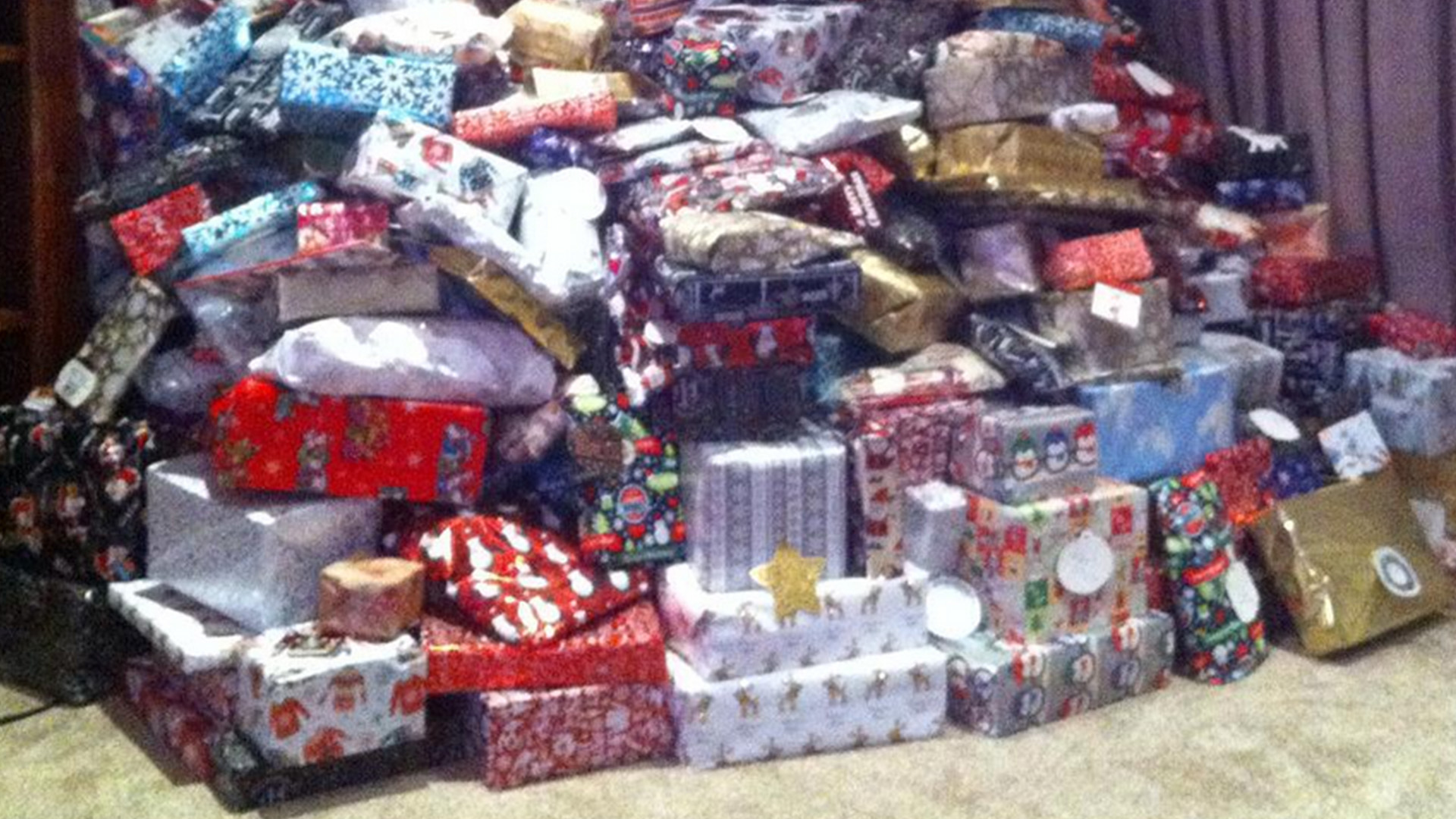 Mother Defends Viral Photo of Family Christmas Tree Piled High with Presents