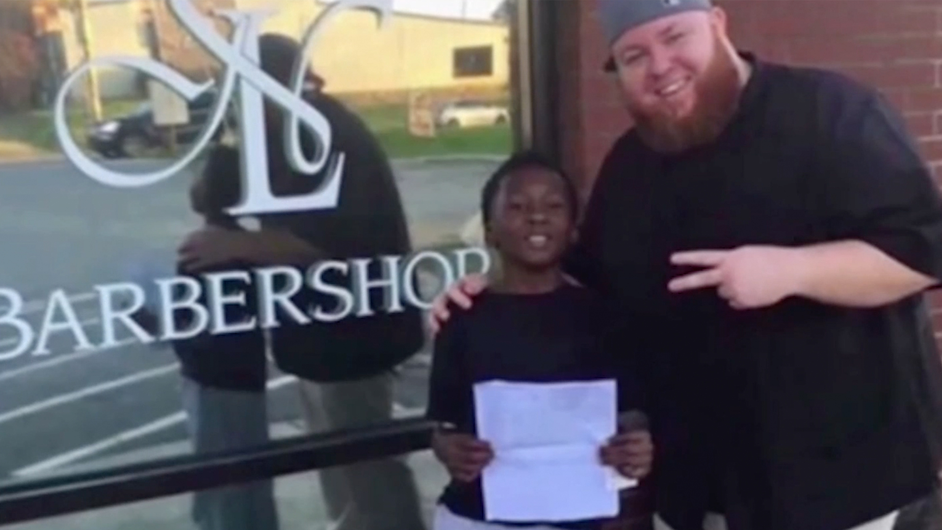North Carolina Barber Promises Haircuts for Life to 9-Year-Old Who Made Straight A's: 'I Believed That He Believed in Me'