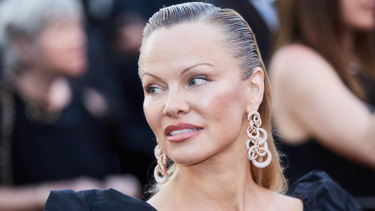 Pamela Anderson Looks Almost Unrecognizable as She Pumps Up the Glamour at Cannes
