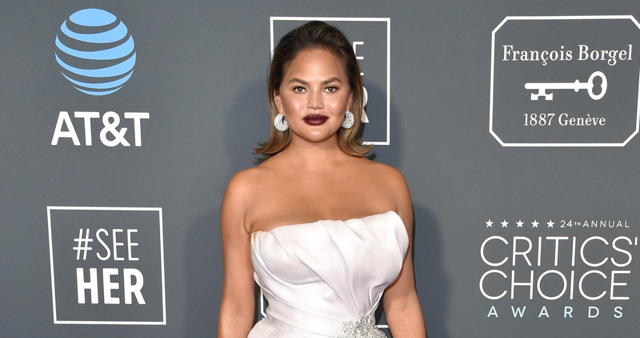 Chrissy Teigen Poses with Her Legs in the Air During Body Makeup Session