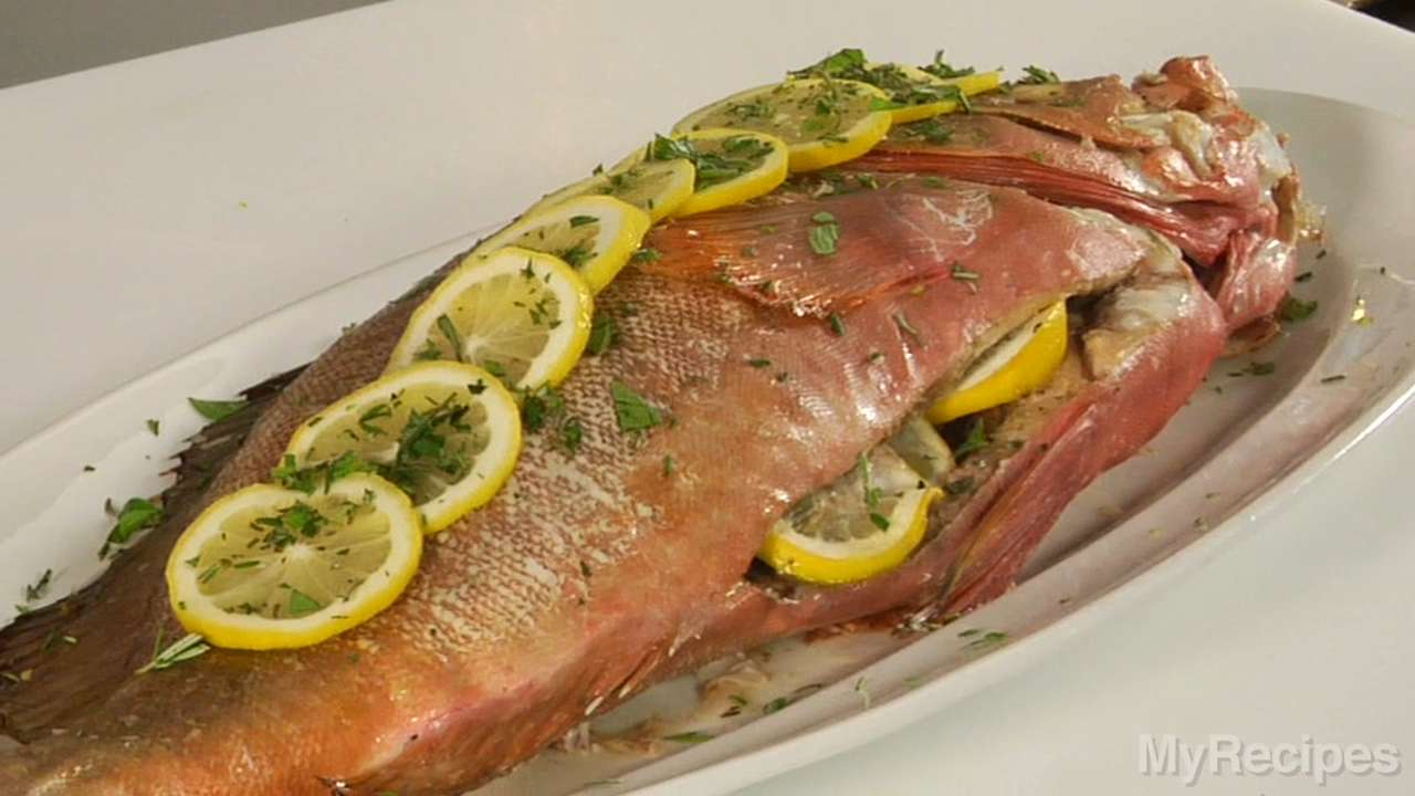 Stuffed whole roasted yellowtail snapper recipe myrecipes for How to cook whole fish in the oven